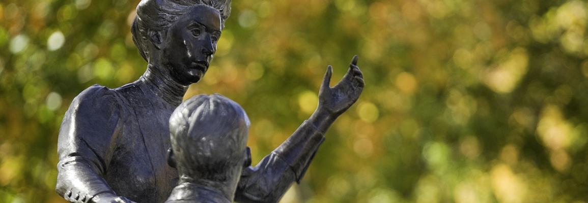 Campus statue of female instructor