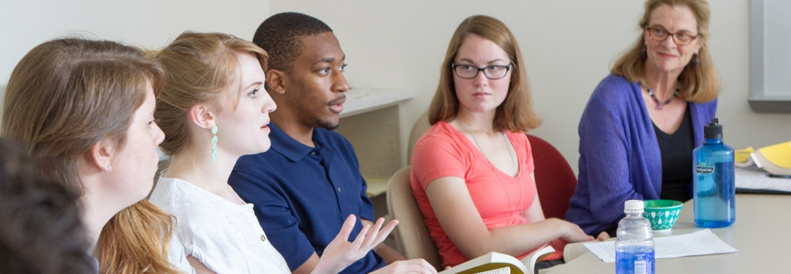 students having a discussion in classroom